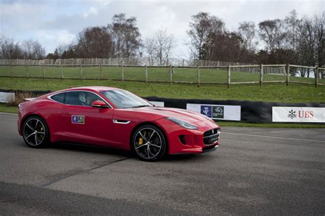 prince harry drives the jaguar f type coupe at goodwood