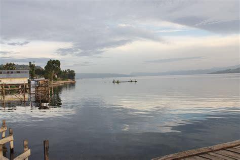 Morning Danau Toba lake toba festival dances rituals and boat races latitudes