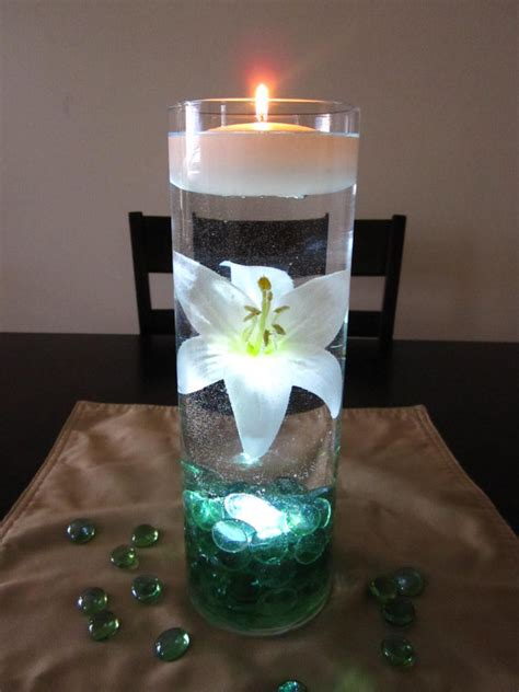 water vase centerpieces white is beautifully suspended in water with sea green marbles