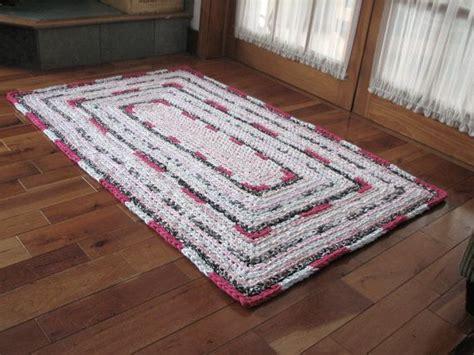 large rink rectangular crocheted rag rug