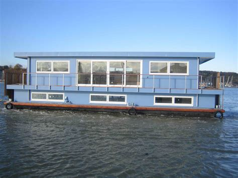 Handmade Houseboats - houseboat custom designed by dirkmarine build on a