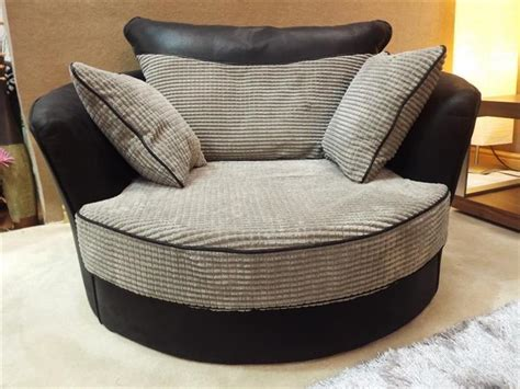 swivel cuddle chair rio grande jumbo black grey fabric cord cuddle swivel