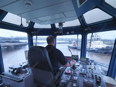 tugboat wheelhouse worker driving tugboat in wheelhouse stock image f006