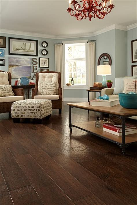 home floor and decor love the ottoman and dark wood floor and wall color