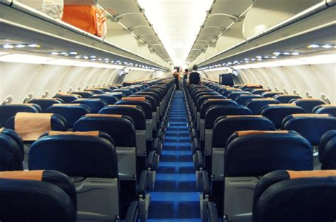 Airplane Cabin by Passengers Evacuated From Smoke Detected Plane