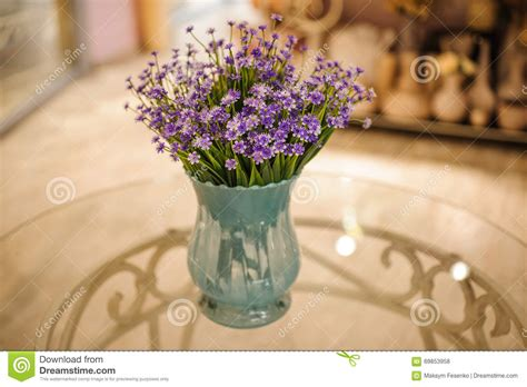 bouquet of beautiful purple flowers in a vase on table
