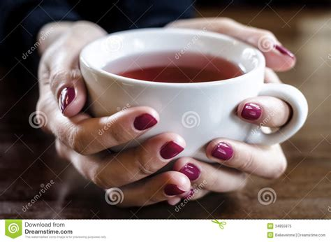 A Cup Of Tea In Hand Royalty Free Stock Photo   Image: 34855875