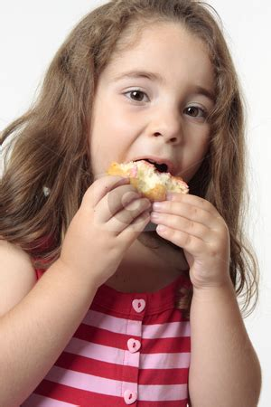 child eating junk food donut stock photo