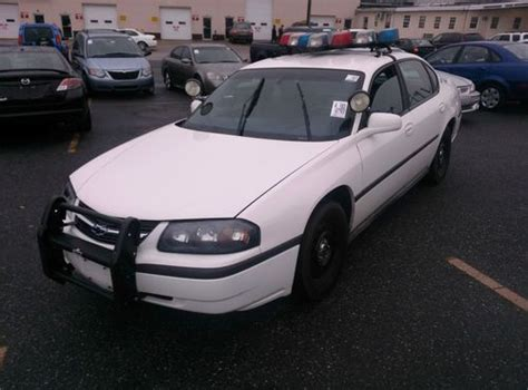 find   chevrolet impala sedan  door  police