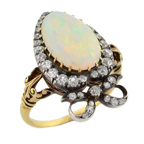 I Ring Mica Motif opal gold crown and motif ring at