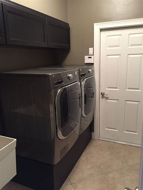 ikea laundry room hack turned ikea kallax shelves into a washer dryer pedestal