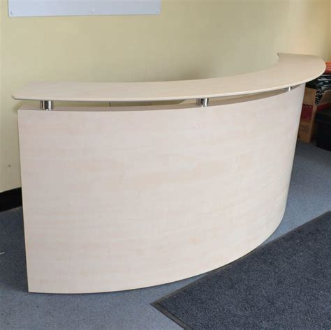 light maple curved reception desk