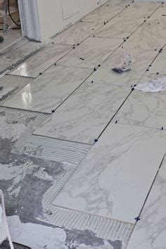 ceramic tile floor trend domino your guide to a stylish home shop style selections tousette gray ceramic floor tile