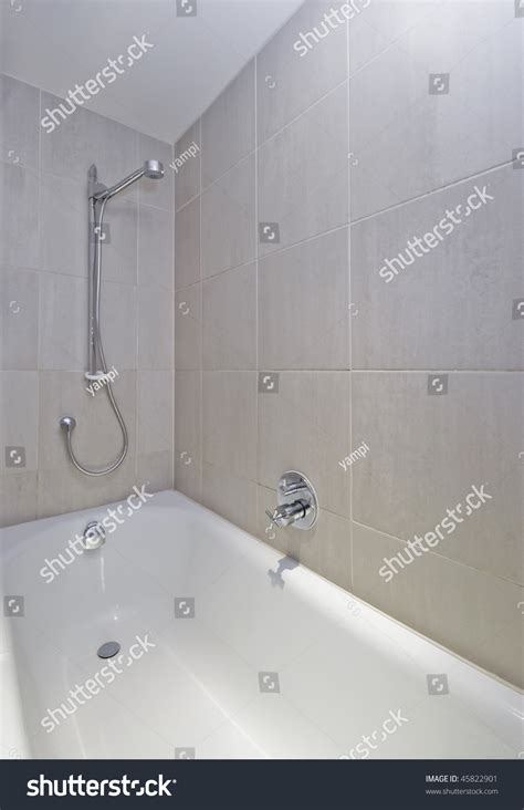 bath tap with shower attachment modern bath tub shower attachment wall stock photo