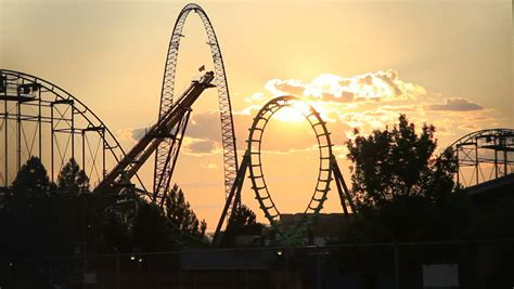themes in the story when the sun goes down this is a sunset shot of a theme park in which a roller