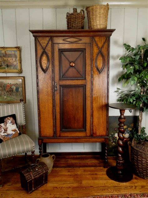 english barley twist legs foyer buffet sofa hall accent english antique jacobean armoire with handsome crown