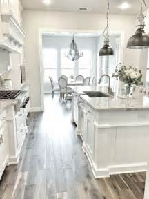 Small Gray Wood Floors In White Kitchen Gen4congress
