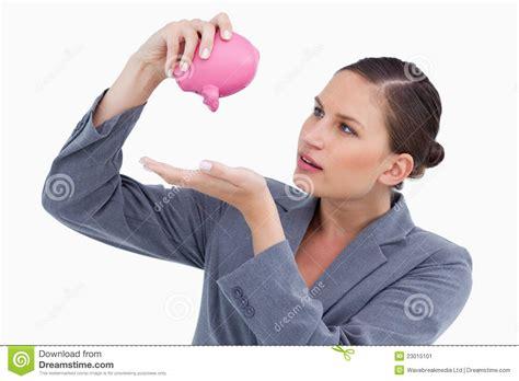 bank clerk bank clerk emptying piggy bank stock image image 23015101