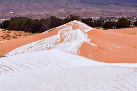 sahara desert snow cold weather conquers africa as a rare snow blanket covers the sahara desert