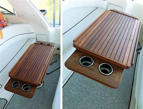 nt marine teak table  fiddles  retractable cup