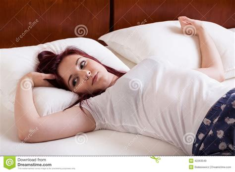 girl in bed young pretty girl lying in bed stock photo image 42263049