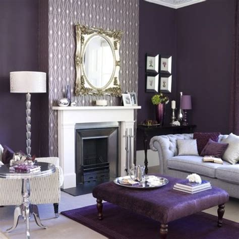 gray and plum living room the plum wall color in this room almost appears gray with this type of muted purple you