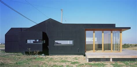 house rubber st black rubber house simon conder associates archdaily