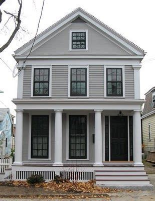 white house with black windows taupe putty color with white cream trim with inside trim