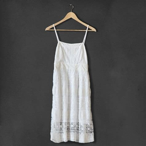 pattern dress lace overlay this classic white dress features a lace overlay with