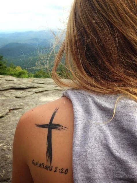 does a tattoo on top of your shoulder hurt cross tattoos for women ideas and designs for girls