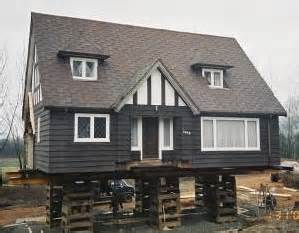 Wonderful Raising A House On Pilings #2: Houseraise.jpg