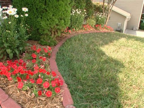 how to edge flower bed installing brick edging video diy