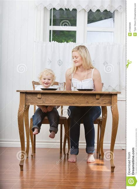 and baby at dining table royalty free stock images