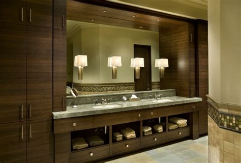 small bathroom sconces creating bathroom lighting that commands attention