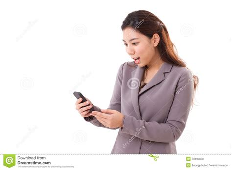 a woman looking at excited surprised business woman looking at her mobile phone stock image image 53492053