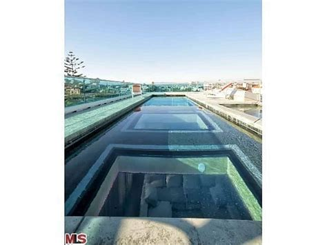 glass bottom pool house and hotel with a glass bottom rooftop pool