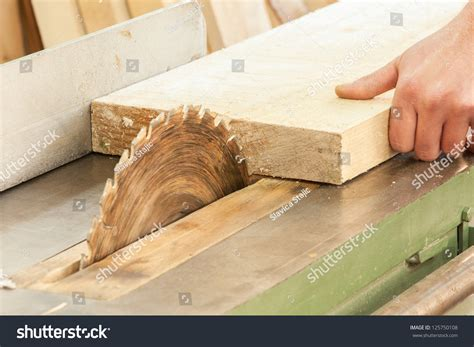 woodworking and carpentry carpenter works on woodworking machine tool stock photo