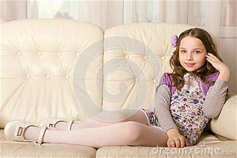 little girls sofa fashion little girl lying on sofa royalty free stock photo