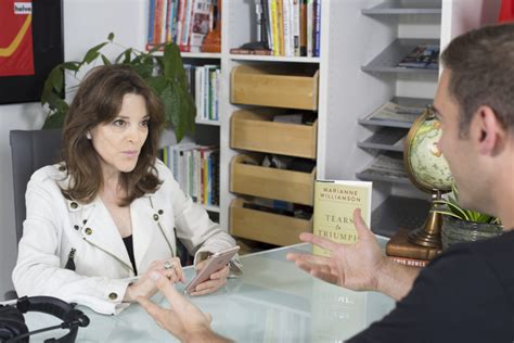 designcrowd lewis howes marianne williamson on pain suffering and finding peace