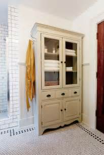 tv armoir to linen cabinet traditional bathroom