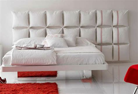 pillowed wall mount headboard and white floating bed