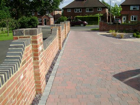 front garden walls ideas grey brick at top of wall to match windows and garage door