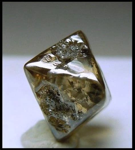 an octahedral diamond crystal with adamantine luster and