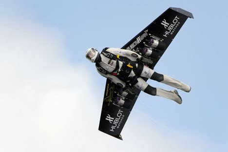 pictured: rocketman flies over alps with jet pack strapped