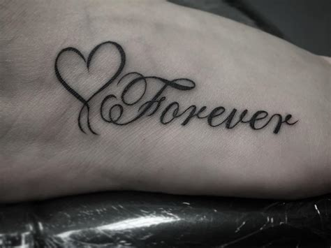 heart tattoo on arm 31 black designs design trends