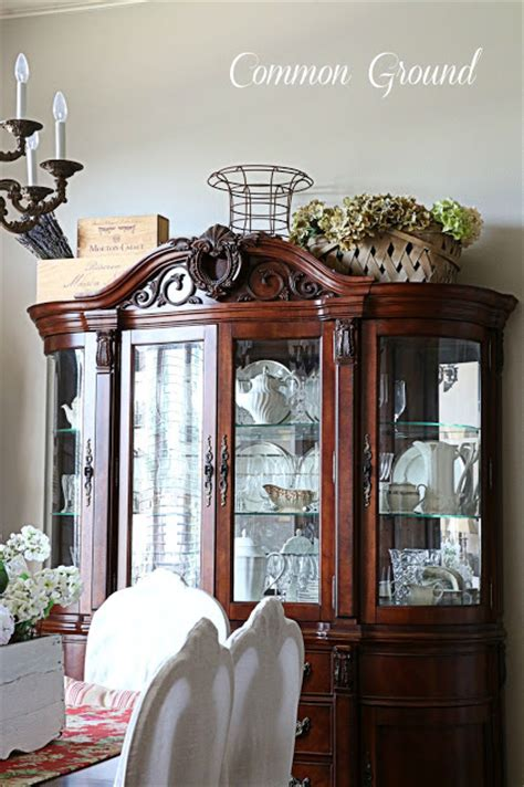 what to put on top of china cabinet common ground ideas on styling a cabinet or cupboard top
