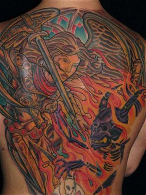tattoo angel killing demon angel killing demon tattoo on back tattoo from itattooz
