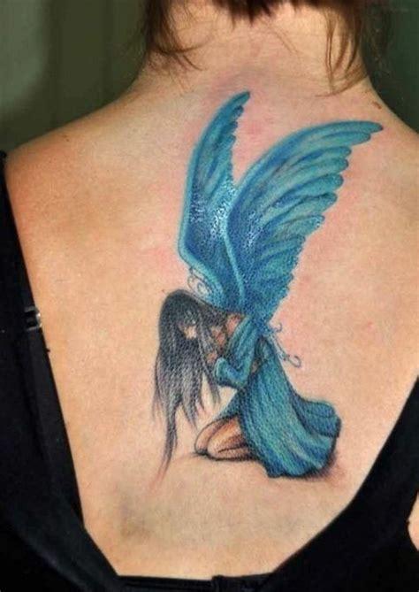 blue sad fairy tattoo on back tattooimages biz
