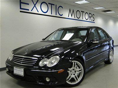 sell used 2006 mercedes c55 amg!! blk/ash nav heated sts