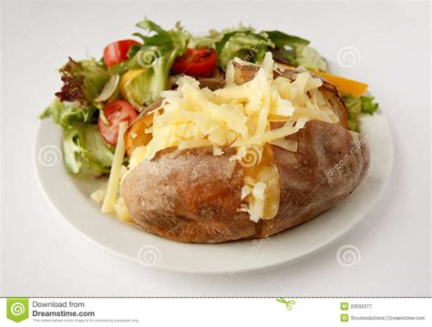 Roasted Root Vegetable - cheese jacket potato with side salad royalty free stock photography image 23592377